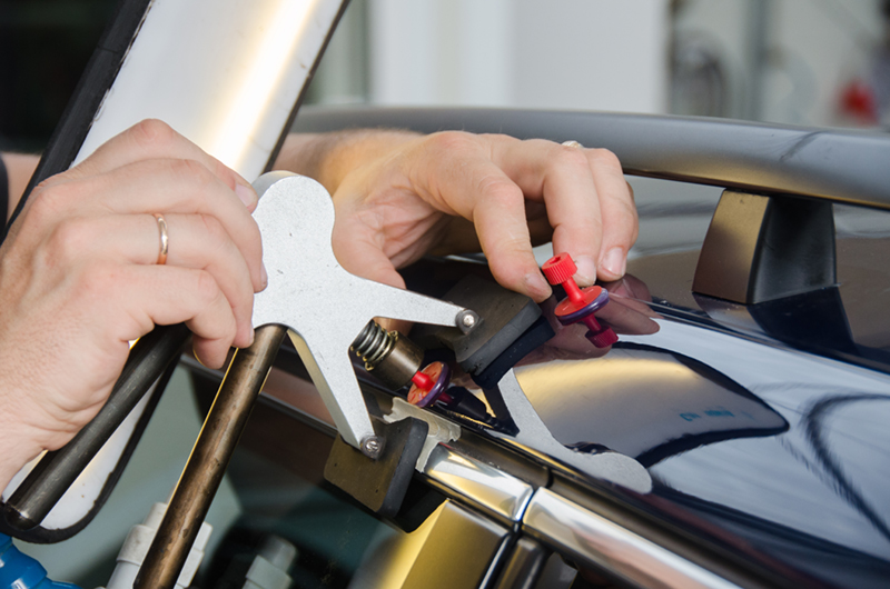 Technician removing a dent